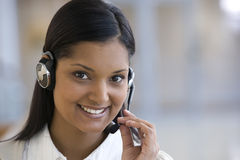 Young smiling call center woman stock image