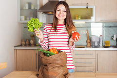 Young smiling caucasian housewife with  shopping bag Royalty Free Stock Images