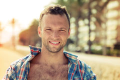 Young smiling Caucasian man outdoor portrait Stock Photos