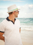 Young smiling Caucasian man in white hat and sunglasses Stock Photo