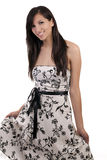 Young smiling caucasian woman standing in dress Royalty Free Stock Photography