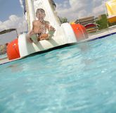 Young smiling child having fun on aquapark Stock Images