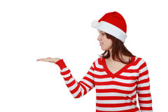 Young smiling christmas woman with hand gesture. And copy space isolated over white background Stock Images