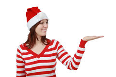 Young smiling christmas woman with hand gesture. And copy space isolated over white background Stock Photos