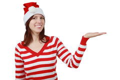 Young smiling christmas woman with hand gesture. And copy space isolated over white background Stock Photo