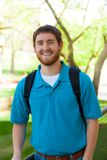 Young, smiling college male student outside Stock Photo