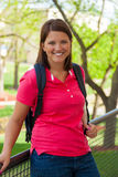 Young, smiling college student outside. A Young, smiling college student outside Stock Photo