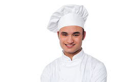 Young smiling confident male chef Stock Images