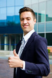 Young smiling confident man doing thumbs up Stock Images