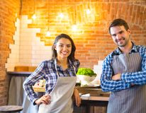 Young smiling couple cooking together Royalty Free Stock Photos