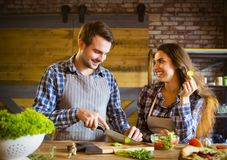 Young smiling couple cooking together stock photo