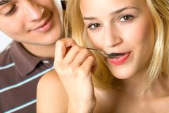 Young smiling couple eating Stock Photo