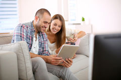 Young smiling couple having fun at home Royalty Free Stock Photo