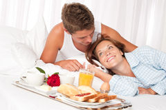 Young smiling couple having luxury breakfast Stock Photos