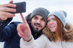 Young smiling couple of hikers taking a selfie royalty free stock photo