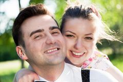Young smiling couple in love portrait in summer park Royalty Free Stock Photos