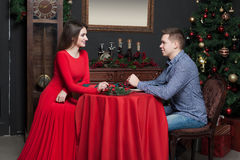 Young smiling couple at luxury restaurant Stock Photography