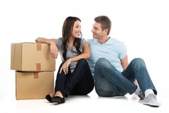 Young smiling couple moving in new house. Stock Images