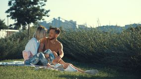 Young smiling couple outdoors Stock Photos