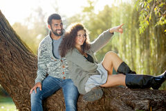 Young and smiling couple relaxing in park Royalty Free Stock Photo