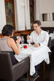 Young smiling couple at the restaurant Royalty Free Stock Image