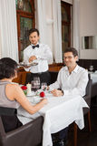 Young smiling couple at the restaurant Royalty Free Stock Images