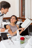 Young smiling couple at the restaurant Royalty Free Stock Photos