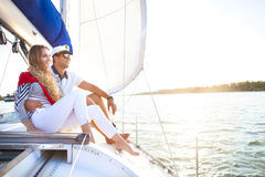 Young smiling couple on a sailing boat at summer Royalty Free Stock Photography