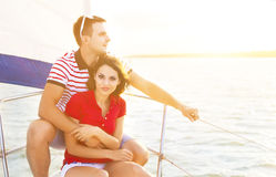 Young smiling couple on a sailing boat at summer Royalty Free Stock Photo