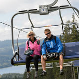 Young couple sitting on chairlift Royalty Free Stock Photo