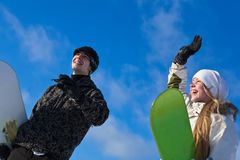 Young smiling couple with snowboards Royalty Free Stock Images