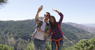 Young smiling couple taking picture of themselves Stock Photography