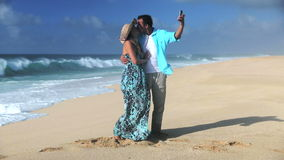 Young Smiling Couple Taking Selfie On Beach. Couple Taking Selfie On Beach Oahu Hawaii stock video