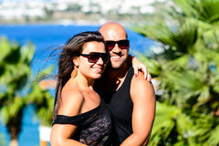 Young  smiling couple. Young  smiling  tanned  happy couple  on tropical beach Royalty Free Stock Photo