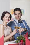 Young smiling couple toasting with rose wine Stock Photos