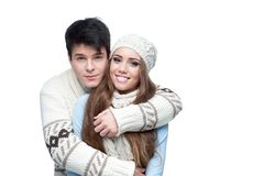 Young smiling couple in winter clothing embracing Royalty Free Stock Image