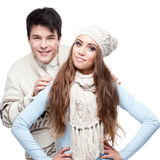 Young smiling couple in winter clothing embracing Royalty Free Stock Photo