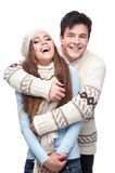 Young smiling couple in winter clothing embracing Stock Image