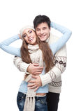 Young smiling couple in winter clothing embracing Stock Photos