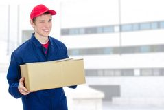 Young smiling courier Stock Image