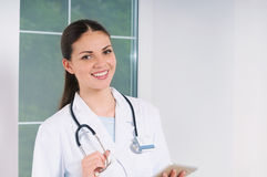Young smiling doctor with medicine equipment working at hospital Royalty Free Stock Photo