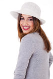 Young smiling face model wearing a coat and hat Stock Photo