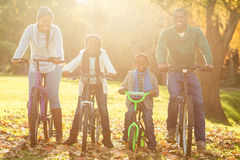 Young smiling family doing a bike ride Stock Photos