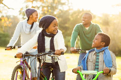 Young smiling family doing a bike ride Stock Image