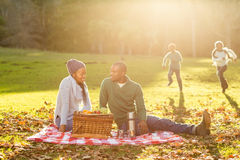 Young smiling family doing a picnic Royalty Free Stock Images