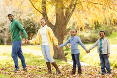 Young smiling family giving their hands to others Royalty Free Stock Images