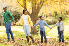 Young smiling family giving their hands to others royalty free stock photos