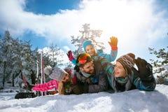Smiling family on winter vacation - Ski, snow, sun and fun. Young smiling family on winter vacation - Ski, snow, sun and fun Royalty Free Stock Image