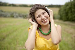 Young smiling fashion girl with headphones Stock Photo