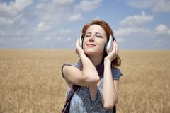 Young  smiling fashion with headphones Royalty Free Stock Images